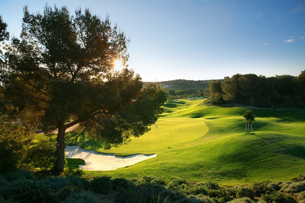 Soleil couchant sur un green du golf Las Colinas